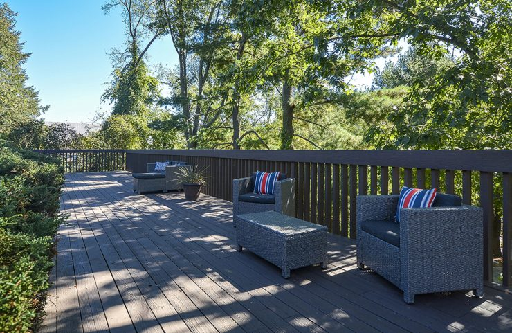 cushioned patio furniture on shaded deck