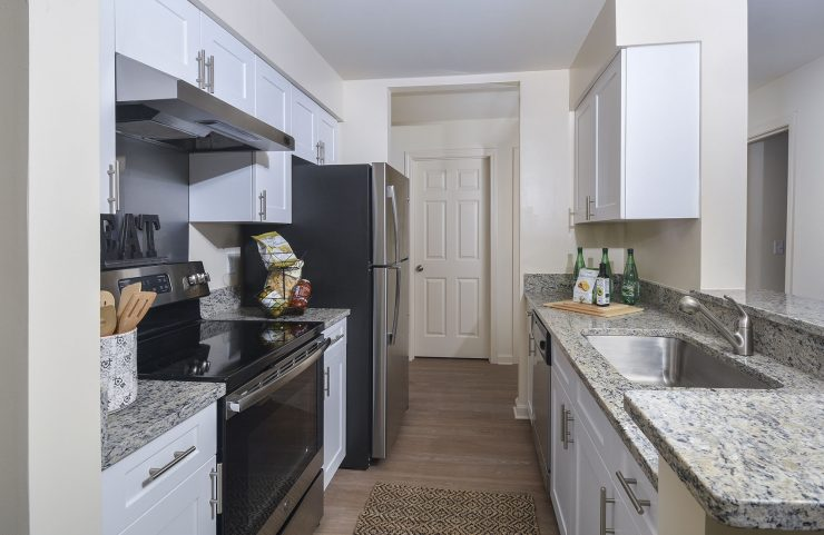 white kitchen cabinets, granite countertops and breakfast bar