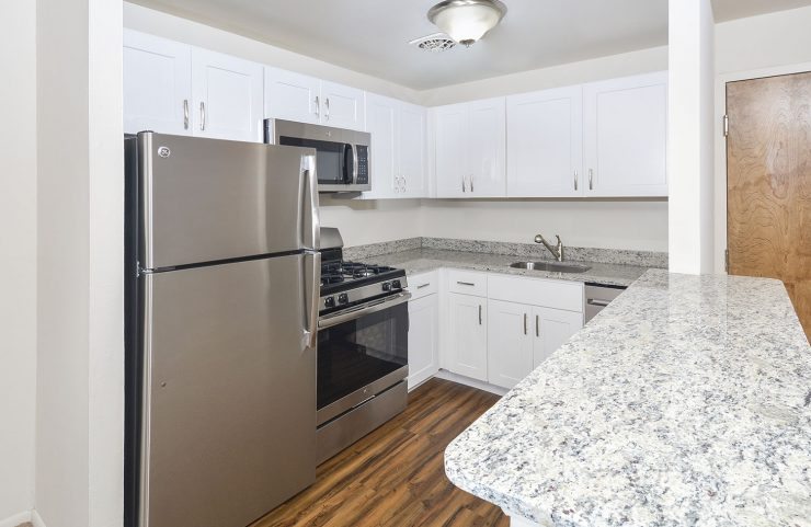 Kitchen with white cabinets and breakfast bar