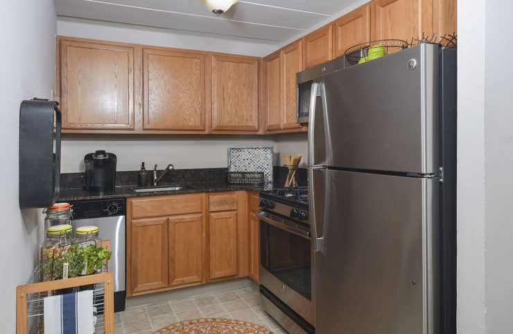 kitchen with stainless steel appliances and oak cabinets