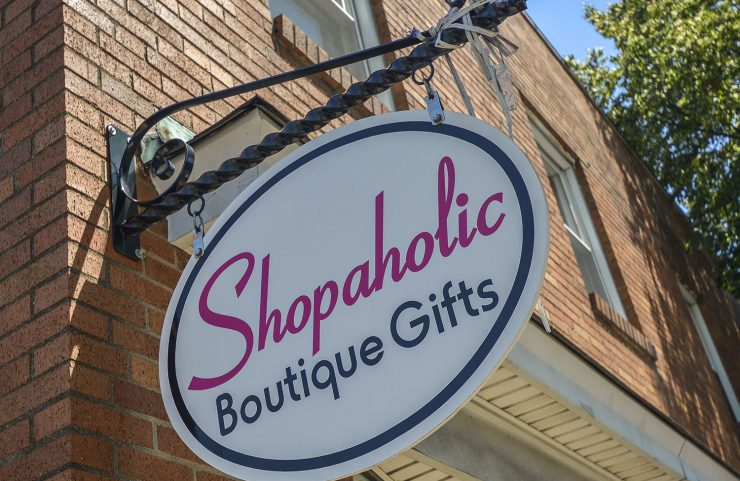 signage of Shopaholic Boutique located on main street