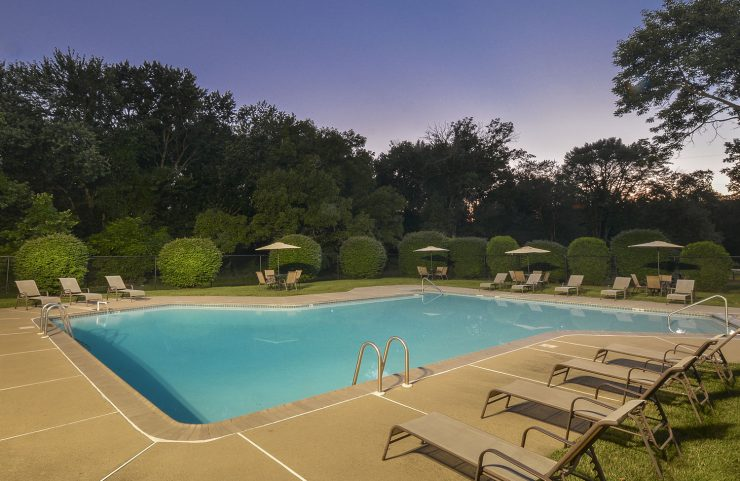 Outdoor Pool at Dusk with lounge chairs