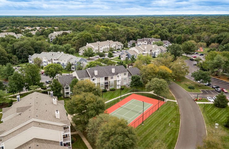 aerial view of tennis court and apartments