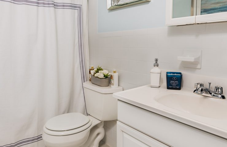 bathroom with white vanity and tub