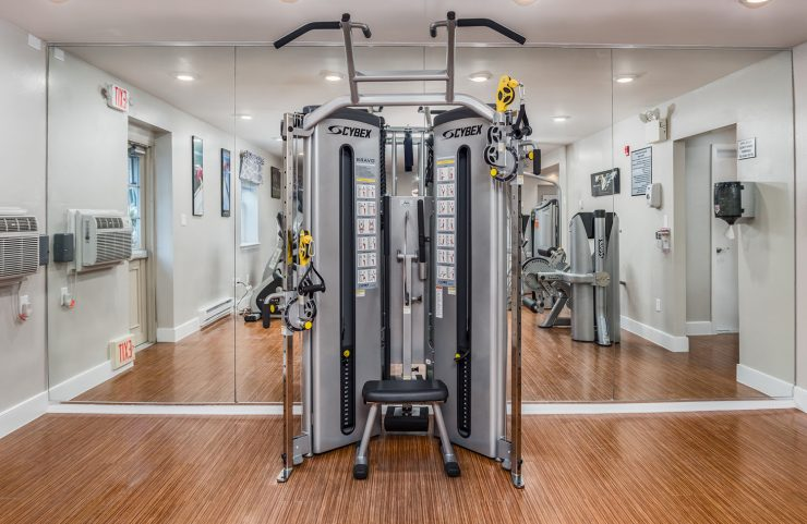 weight machine with mirror in fitness center