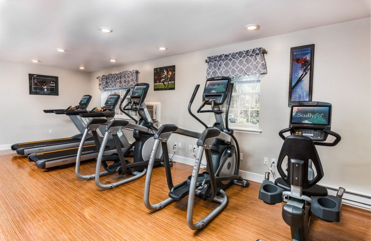 treadmills, ellipticals and bikes in fitness center