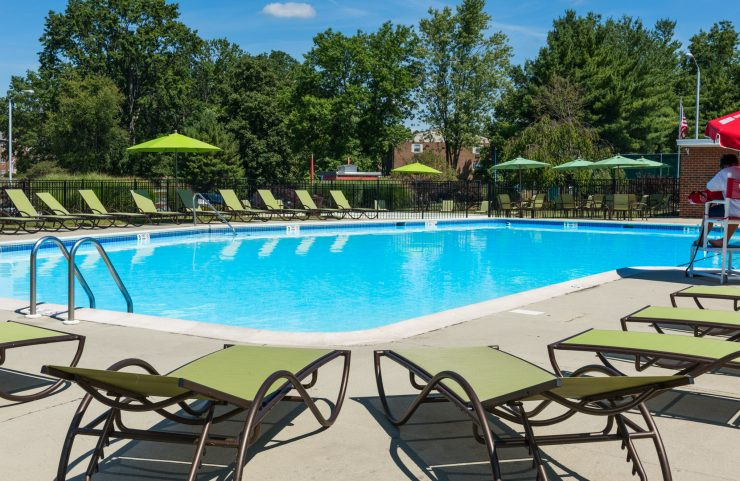 outdoor pool with plenty of new patio furniture