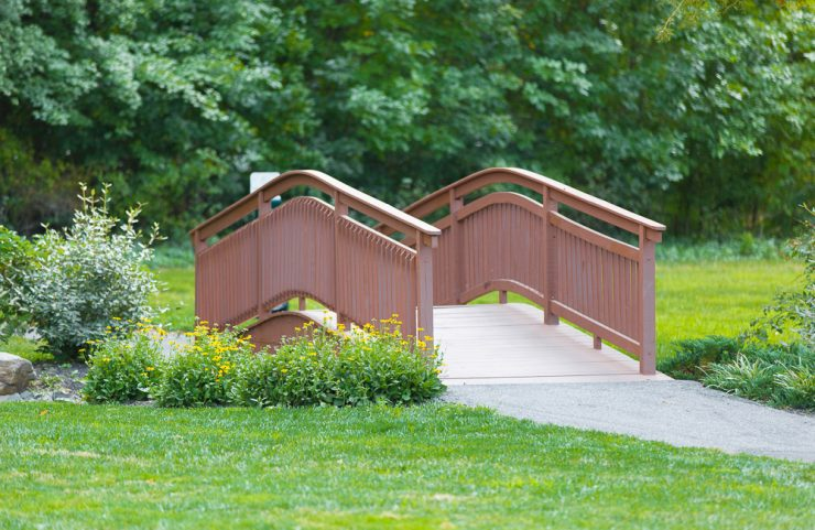 wood bridge along walking path