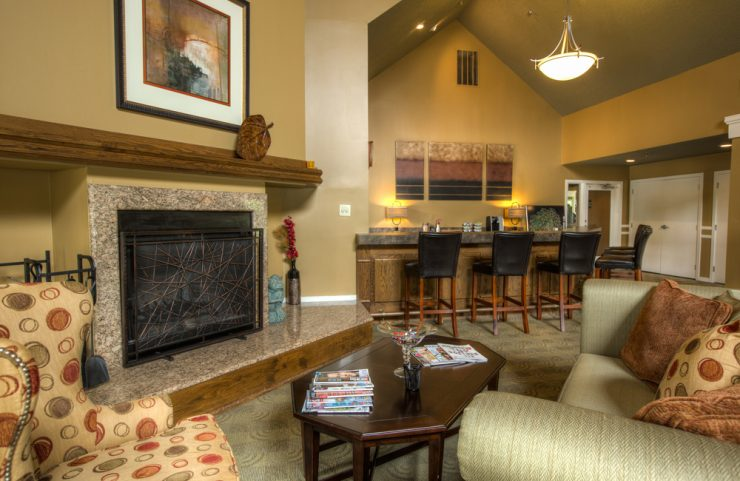 clubhouse with comfy seating and fireplace