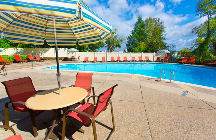 outdoor pool with umbrella tables