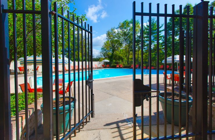 half open gate entering into the pool area