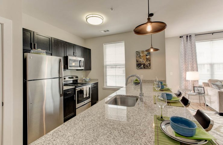 stainless steel appliances and modern fixtures in kitchen