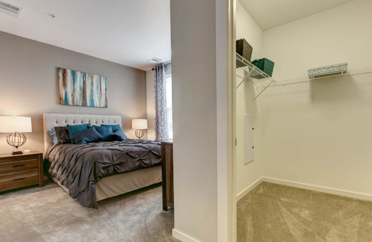 carpeted bedrooms with large walk-in closets