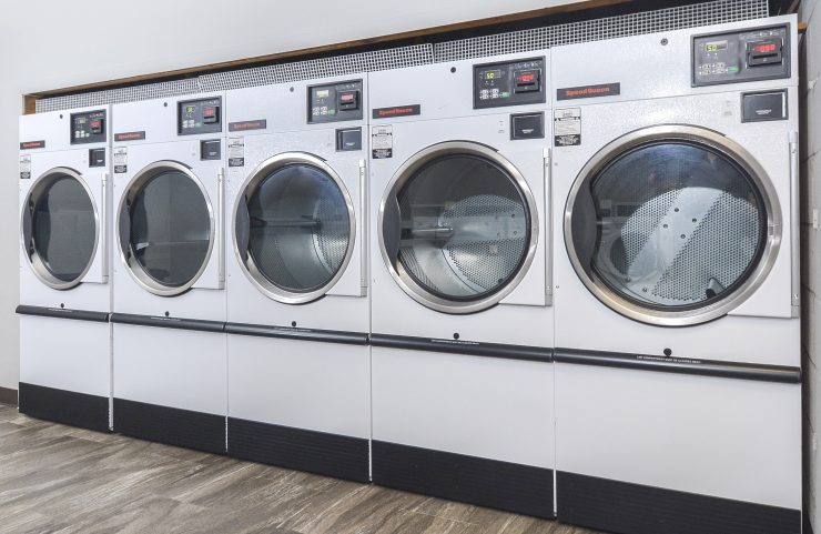 large washer and dryers in laundry room