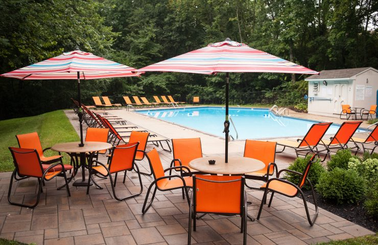 umbrella tables and chairs around the outdoor pool