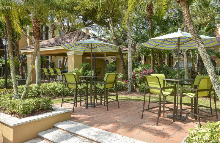 patio seating with high top umbrella tables