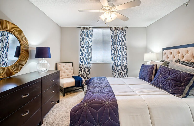 large bedroom with ceiling fan and carpet