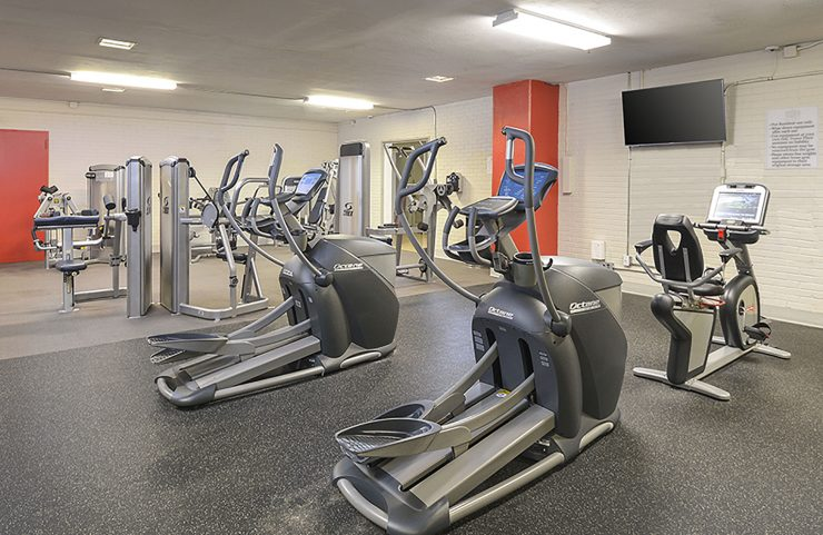 24 hour fitness center with cardio and weight machines