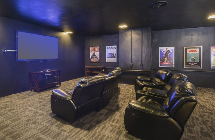 24 hour theater room with recliners