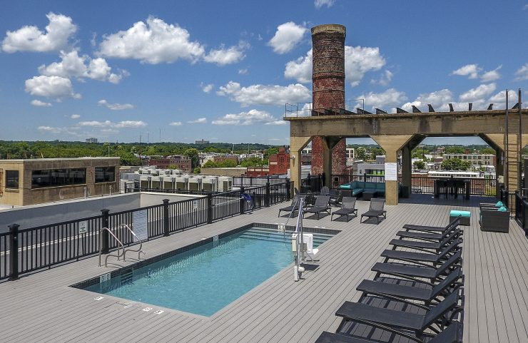 Rooftop pool with lounge chairs
