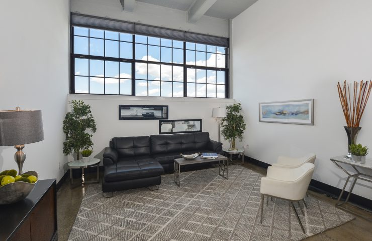 living area with large windows and polished concrete floors