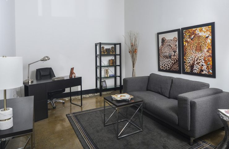 living area large enough for sofa, tables and a desk