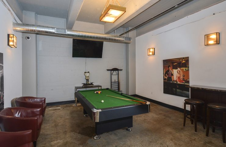 Billiard room with TV and seating
