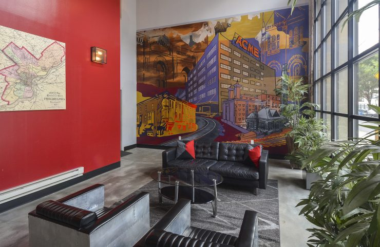seating in the lobby with large colorful mural