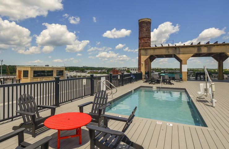 table and chairs by rooftop pool