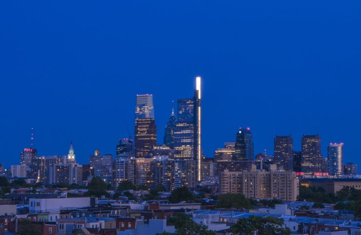view of center city at night from the rooftop deck
