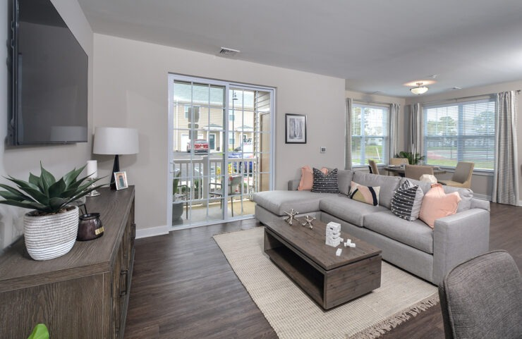 large living room with sliding doors to patio
