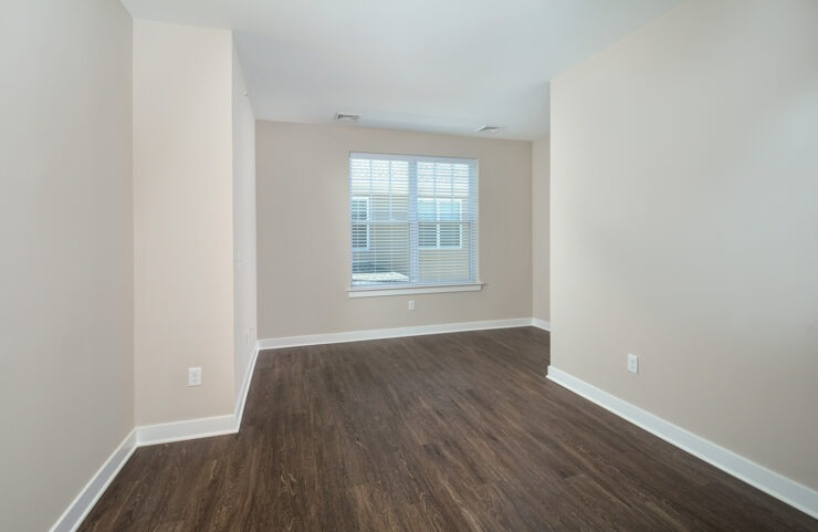 den with plank flooring in select units