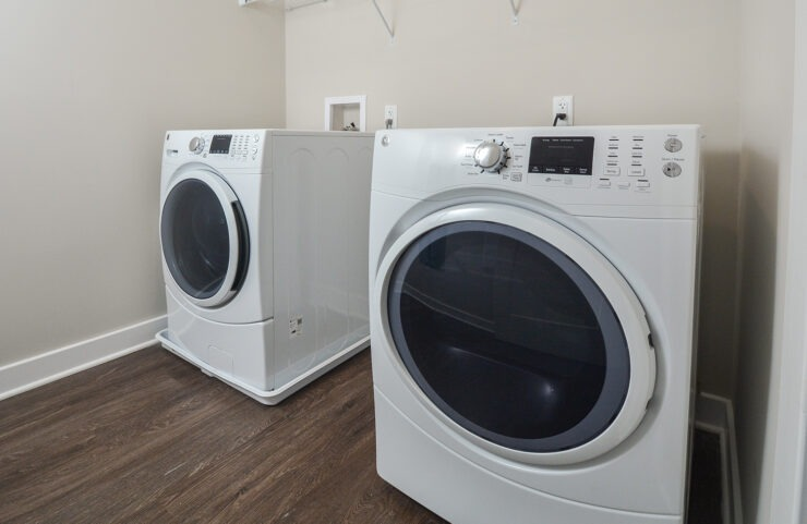 full size washer and dryer in laundry room, select units only