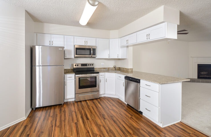 upgraded kitchen comes with white cabinets and stainless steel appliances