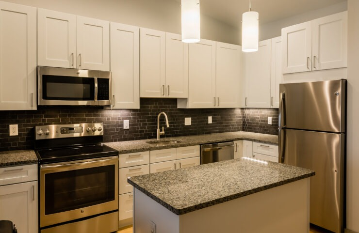Modern Kitchen With Stainless Steel Appliances, Granite Countertops and Designer Lighting